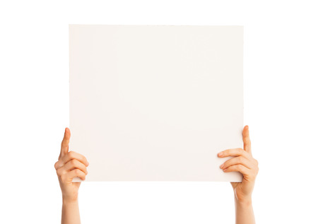 Isolated hands holding a piece of paper up over white background. photo