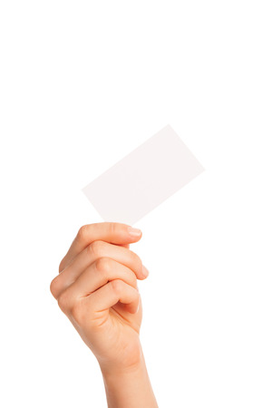 in hand a blank sheet of white paper held diagonally. Isolated, over white background. photo