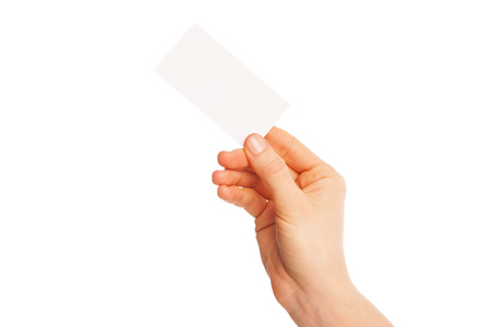 in hand a blank sheet of white paper held diagonally from right to left. Isolated, over white background. photo