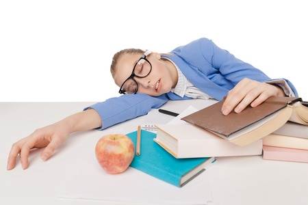 pensil: student girl in big glasses sit and sleep at the table with red apple, many colorful books, copybook and pensil, on  white background