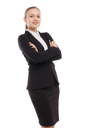 Portrait of beautiful young businesswoman standing arms crossed over white background photo