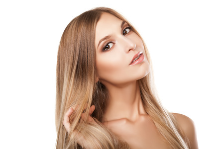 Beautiful woman with long straight blond hairs. Fashion model isolated on white background photo
