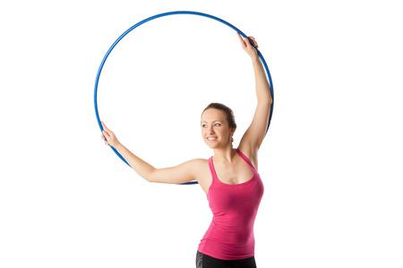 rhythmic gymnastic: Mujer de gimnasia r�tmica con aro e inclinado graciosamente derecha.