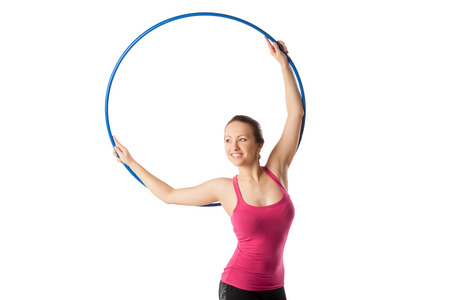 gracefully: Rhythmic gymnastic woman with hoop up and leaning gracefully right.