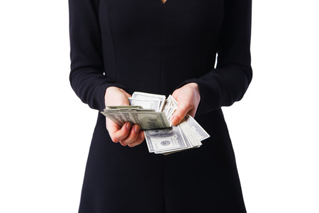 recounts: Woman wearing a black dress recounts dollars, close up Stock Photo