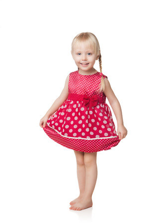 little girl dancing: smiling little girl in red dress isolated on white background Stock Photo