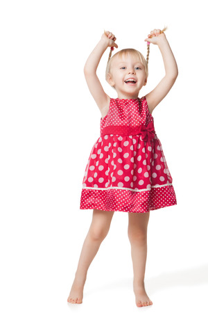 red dress: smiling little girl in red dress isolated on white background Stock Photo