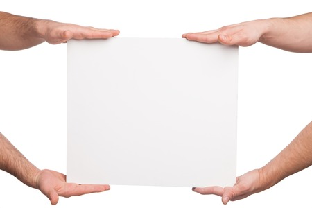 four hands: four hands holding a blank white board. isolated on white