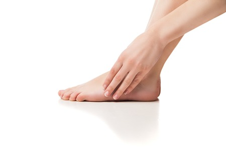 feet naked: Woman foot on white background, isolated, close-up Stock Photo