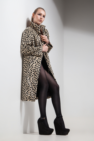 sexy black girl: beautiful young Girl in leopard print coat over white background