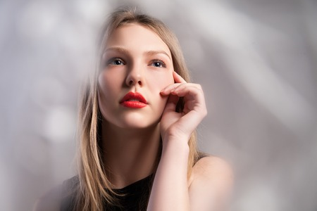 full red: Closeup of Stylish young beautiful girl in elegant black dress with full red lips