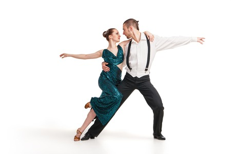 DAnce background: Beautiful two professional artists dancing over white background Stock Photo