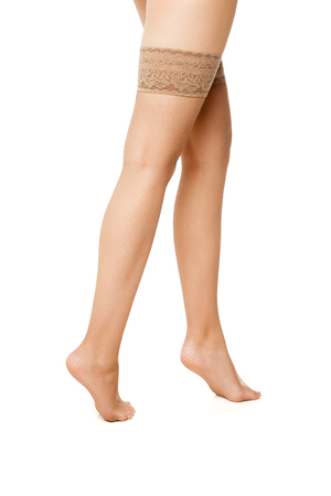 incognito: Unrecognizable woman in beige stockings isolated over white background