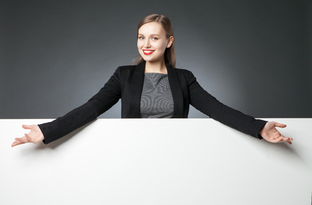 blank space: Woman presenting blank space with wide arms Stock Photo