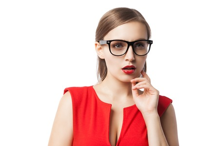 open lips: Portrait of beautiful young woman in red dress and glasses looking away with open red lips