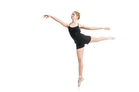 weightless: Portrait of female ballet dancer jumping. Isolated