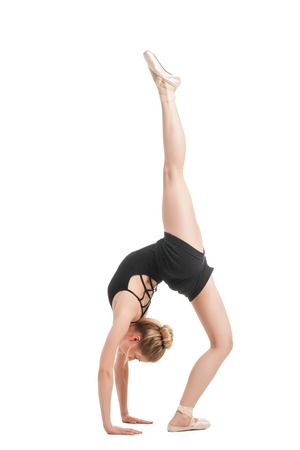 split up: Blonde ballet dancer in split with leg up Stock Photo