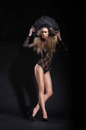 kokoshnik: Studio shot of young model with make-up wearing body and kokoshnik looking away.