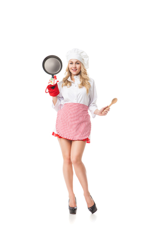 sirvientes: Portrait of smiling waitress with pan and spoon.Studio shot