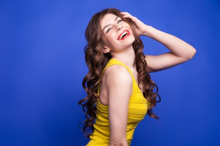 jovial: Portrait of smiling brunette girl with long wavy hair.Isolate Stock Photo