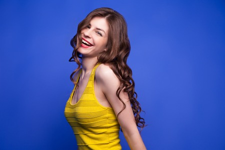 pretty dress: Portrait of smiling brunette girl with long wavy hair.Isolate Stock Photo