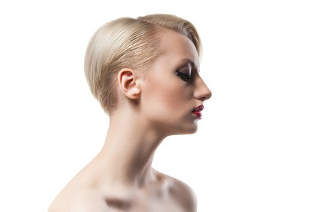 horizontal haircut: Side view of short-haired blonde girl with red lips and bare shoulders on white background.Isolate