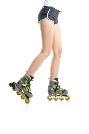 rollerskates: Close up  picture of womans legs with rollerskates isolated on white