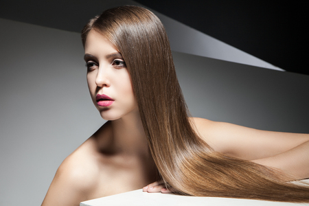Close-up of attractive young woman with beautiful long hair