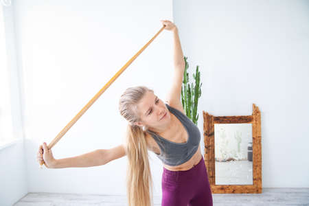 Happy female athlete exercising with elastic band Standard-Bild