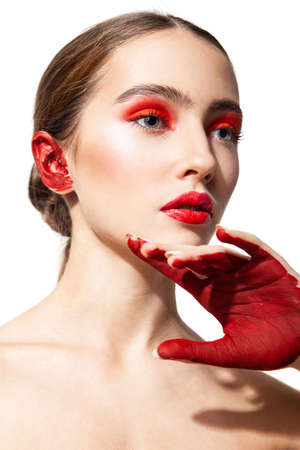 Woman with red makeup and painted hand