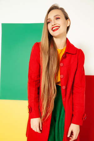 Smiling fashionable woman in bright colorful outfit