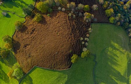 An aerial shot of a yorkshire dales landscape showing the brown foliage of ferns that have died