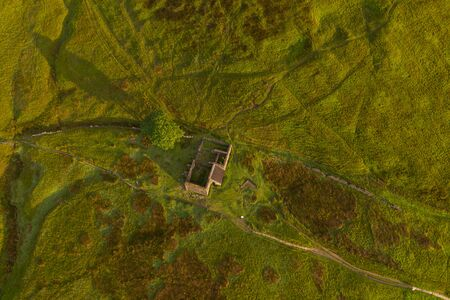 An aerial Sunrise drone shot of Top Withens or Top Withins, this farmhouse has been associated with Banque d'images