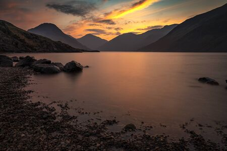 Sunrise over Wast Water a lake located in Wasdale, a valley in the western part of the Lake District National Park, England, it is the deepest lake in England at 258 feet Stockfoto