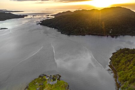 Aerial drone shot of Castle Tioram, it is a ruined castle that sits on the tidal island Eilean Tioram in Loch Moidart, Lochaber, Highland, Scotland. It is located west of Acharacle.