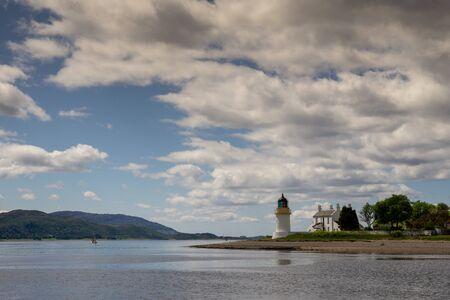 White Corran Lighthouse bathed in summer sunshine Foto de archivo