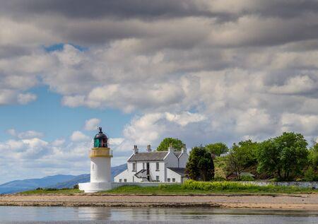 White Corran Lighthouse bathed in summer sunshine Banco de Imagens
