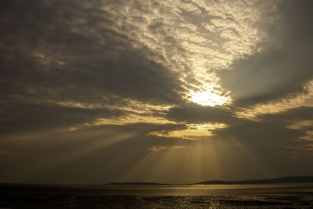 Sunset over Morecambe Bay the largest estuary in northwest England, just to the south of the Lake District National Park. It is the largest expanse of intertidal mudflats and sand in the United Kingdom,