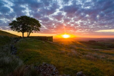 """An aerial Sunrise drone shot of Top Withens or Top Withins, this farmhouse has been associated with """"Wuthering Heights""""."""