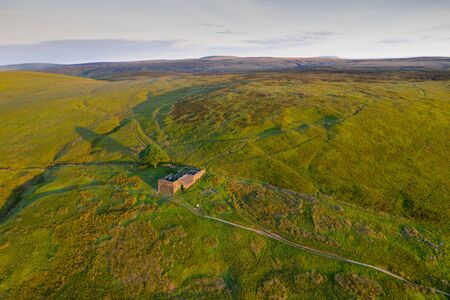 "An aerial Sunrise drone shot of Top Withens or Top Withins, this farmhouse has been associated with ""Wuthering Heights""."