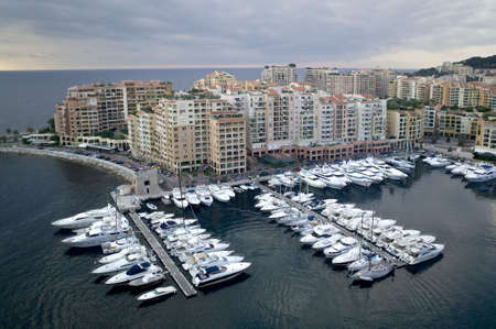 Harbor of Monte Carlo. Seen from Grimaldis Palace. In the background the skyline of Monaco. Stock Photo