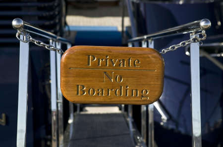 Wooden prohibition sign belonging to a luxury yacht at Monaco.