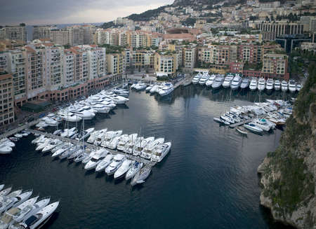 residental: Harbor of Monte Carlo. Seen from Grimaldis Palace. In the background the skyline of Monaco. Stock Photo