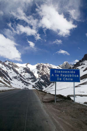 bienvenido: Road sign at the Andes border of Argentina and Chile: Welcome to the Republic of Chile. Stock Photo