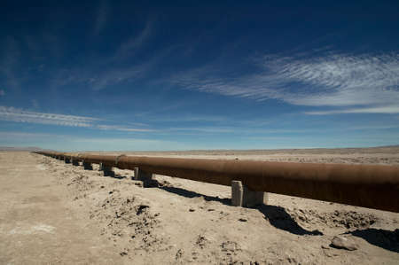 Rusty pipeline through the Atcama Desert, Chile. Stock Photo - 2874896