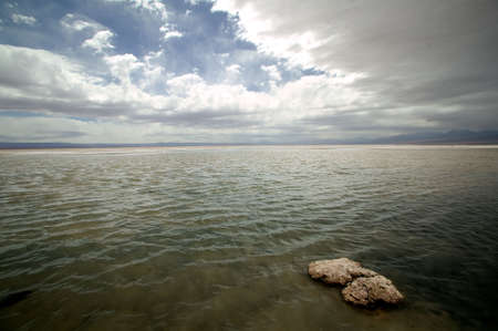 Panoramic view on a salt lake with dramatic cloudscape, located at Atacama Desert, Chile. Stock Photo - 2874904