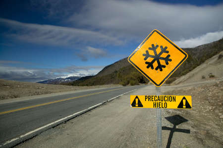 Blazing yellow road sign in the Andes. Stock Photo - 2874911