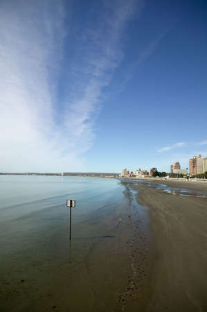 Nice coastline with deep polarized sky and the skyline of Puerto Madryn, Argentina.  Stock Photo - 2874850