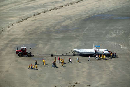 whale watching: Tractor, whale watching boat, waiting for passengers at the beach of Puerto Piramides, Argentina.