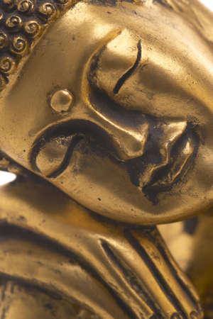 buddha face: Detail shot of a golden Buddha statue